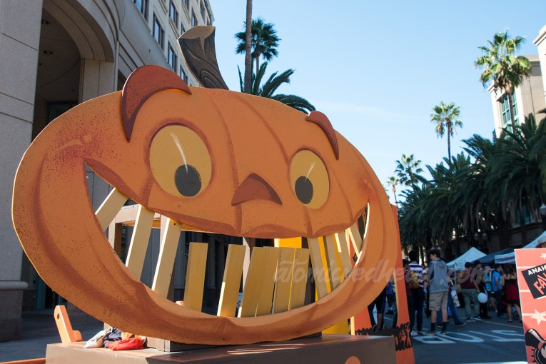 A large wooden painted jack o'lantern with teeth that can be hit out as a carnival game.
