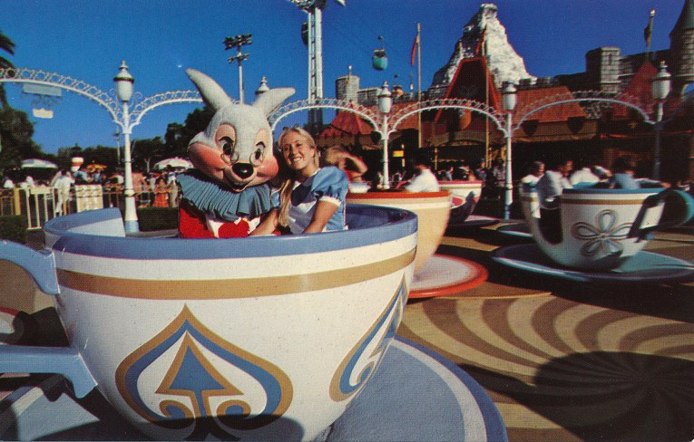 Alice and the White Rabbit ride in a giant blue and white tea cup.