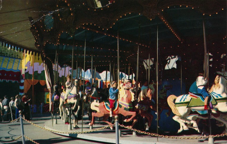 Children ride board horses on King Arthur's Carousel.