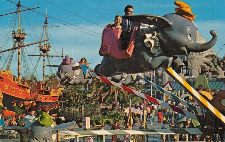 Guests ride high aboard Dumbo.