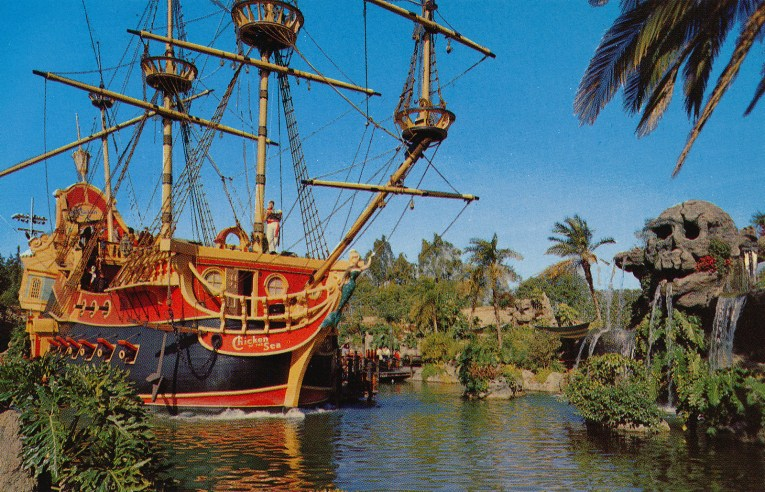 The Chicken of the Sea Shop, a brightly colored pirate ship with red and yellow strip sails. Nearby is Skull Rock.