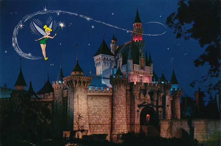 Sleeping Beauty's Castle at night, Tinkerbell flies above.