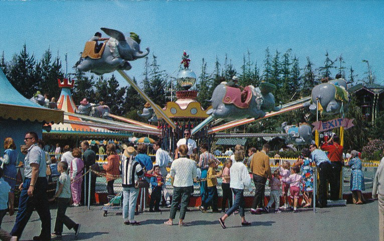 Guests spin around and ride aboard Dumbo, the flying Elephant.