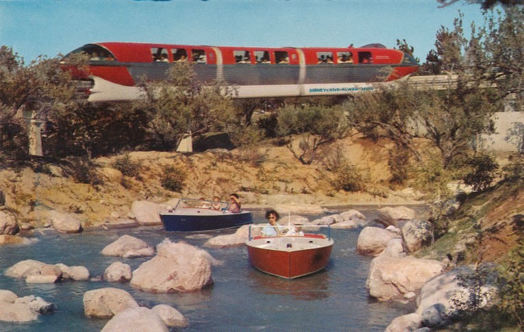 The Motorboat Cruise, small boats through waterways with small rocks. The Monorail glides by in the background.