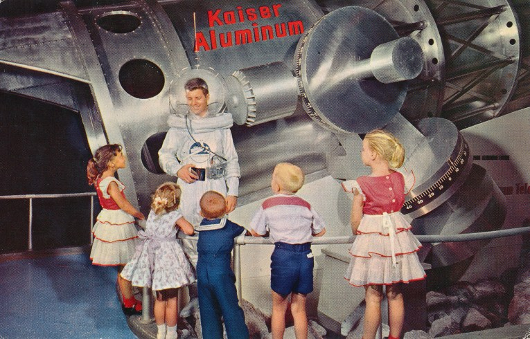 A man in a fanciful space suit interacts with children.