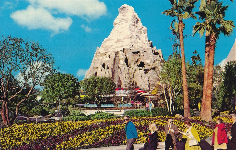 The Matterhorn looks slightly out of place as it stands in the distance with palm trees nearby.