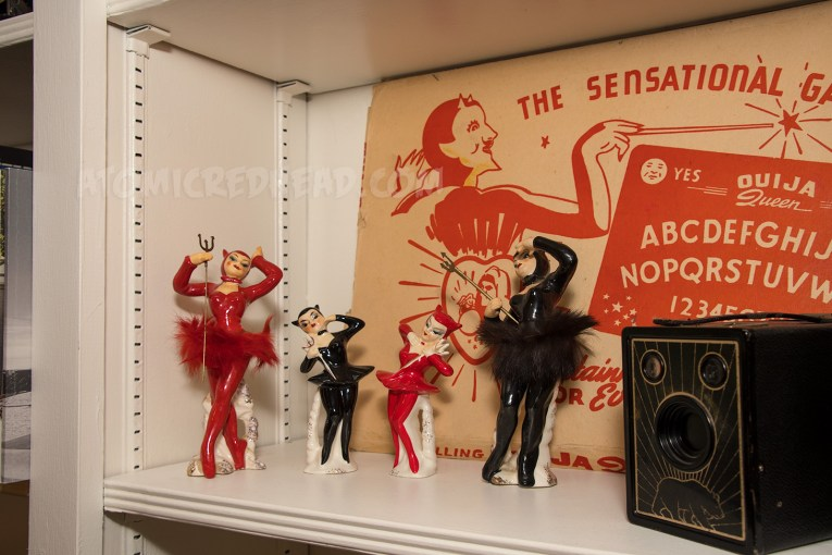 Four ceramic devil girls, with fur tutus and ballet slippers.