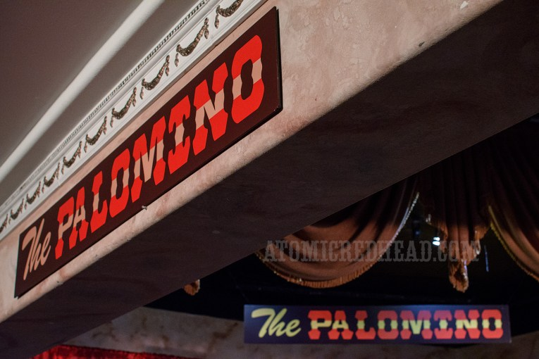 "Inside small signs reading ""The Palomino"" hang."
