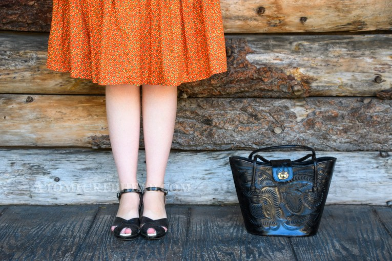 Close-up of my black tooled leather peep toe shoes, and black tooled leather purse.
