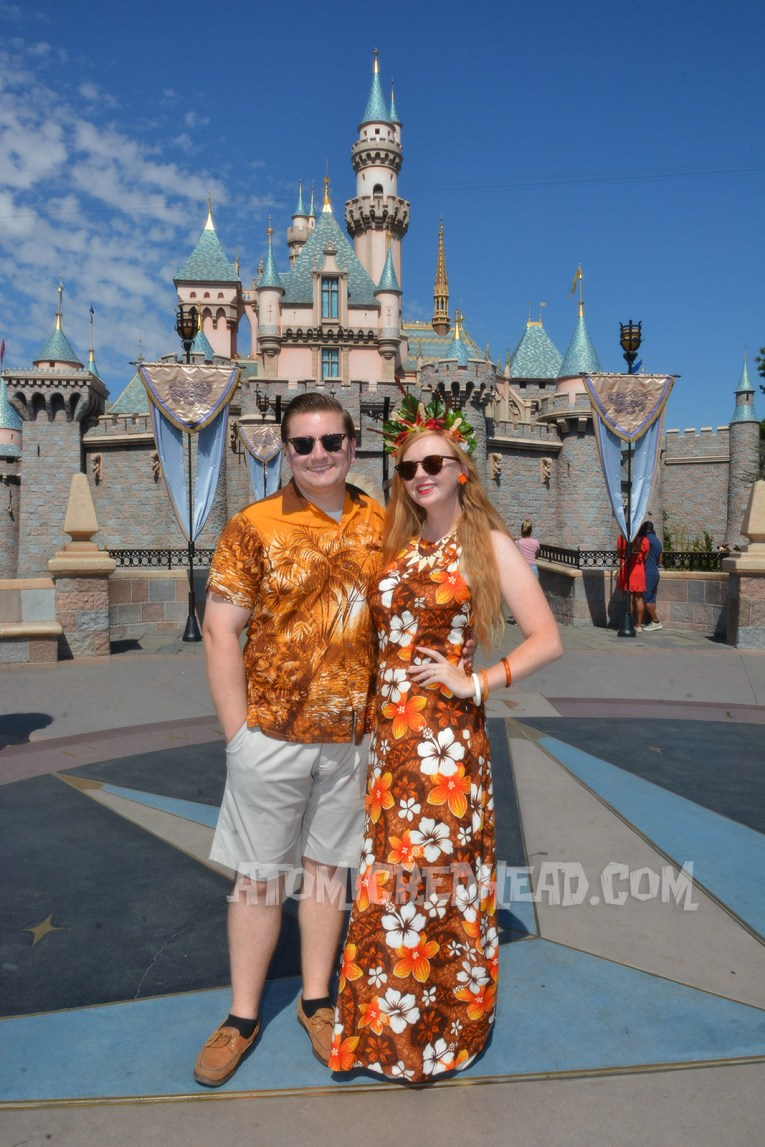 Patrick and myself in front of Sleeping Beauty Castle. Patrick wearing a tan, brown, orange, and cream button down shirt with a palm print on it, khaki shorts, and brown shoes.