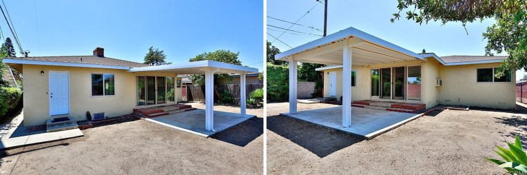 A covered patio extends out of the house into a dirt lot.