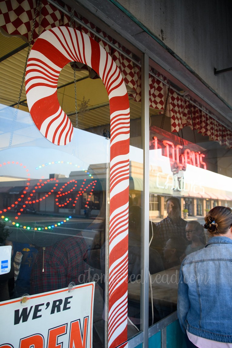 A large candy cane painted on the outside window.