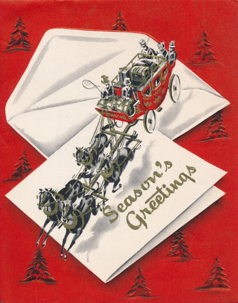 "A carriage is pulled by four horses across a large envelope and card, which reads ""Season's Greetings"""