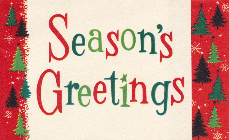 "A white card is edged in red with small green trees on each side. In the center, it reads ""Season's Greetings"""