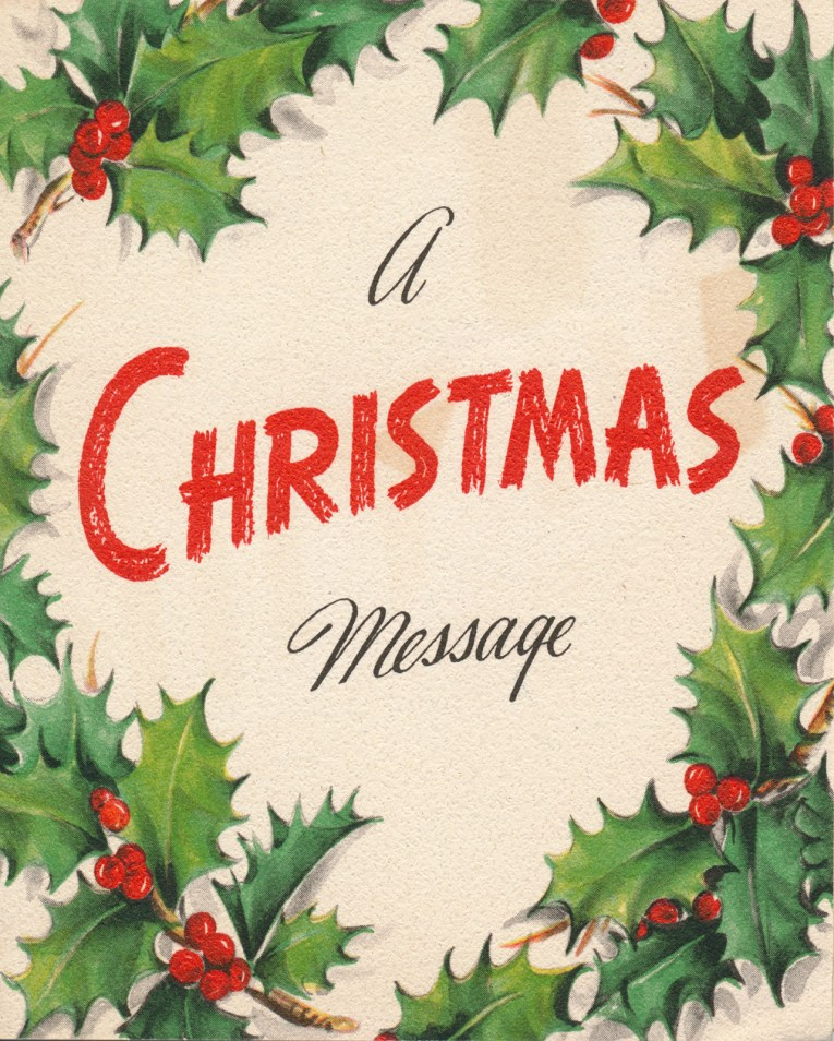 "A white card edged in holly, in the middle it reads ""A Christmas message"""