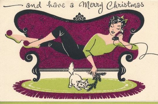 "A girl in a green shirt and black pants sits on a purple couch, she is on the phone and playing with her cat who is on the floor. Across the top it reads""and have a Merry Christmas"""