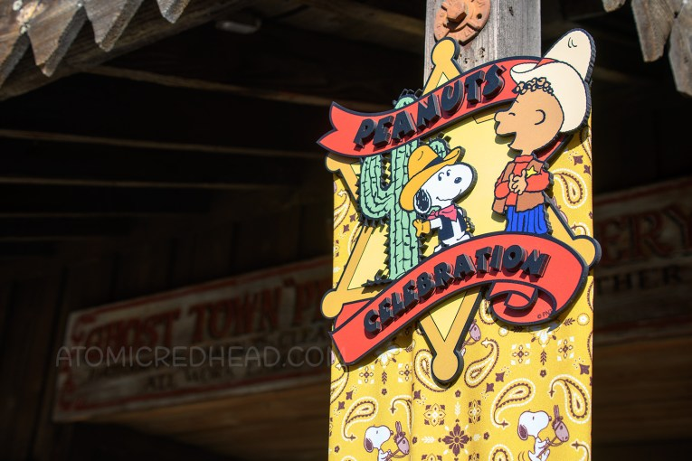 """A small plaque shaped like a sheriff's badge features cowboy versions of Snoopy and Franklin, and reads """"Peanuts Celebration"""""""