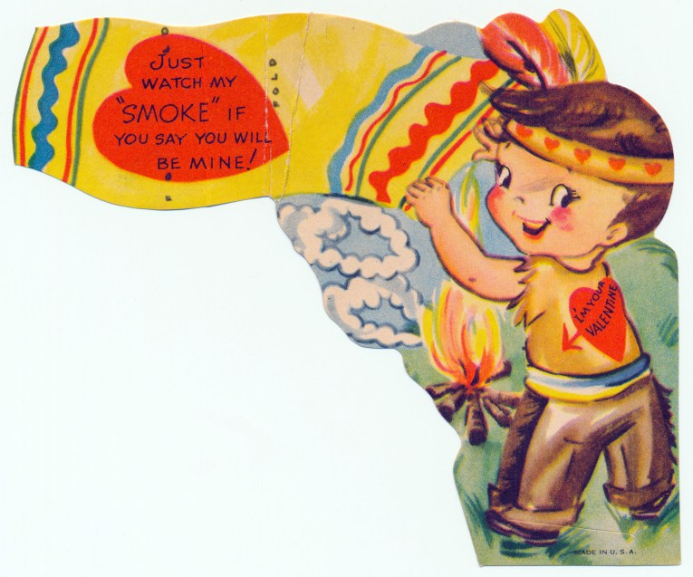 """A little boy dressed as an Indian waves a blanket over a fire creating smoke rings that look like hearts. Text reads """"Just watch my 'smoke' if you say you will be mine! I'm your valentine."""""""