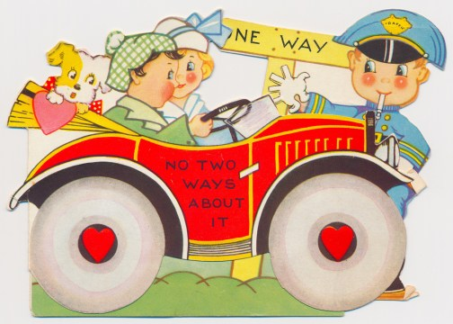 "A couple and a dog drive in a red car, a cop stands near the front gesturing to a ""One Way"" sign. Text on the door of the car reads ""No two ways about it"""