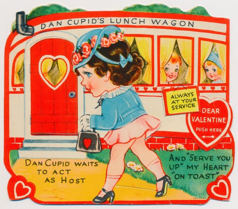 "A girl walks up to a small diner, that reads ""Dan Cupid's Lunch Wagon"" across the top, a little sign reads ""Always at your service"" and other text reads ""Dan Cupid waits to act as host and 'serve you up' my heart 'on toast'"""