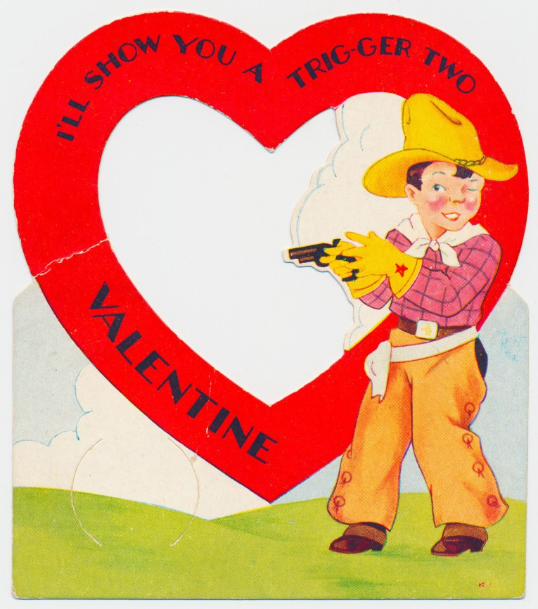 "A cowboy stands near a large heart, text inside the heart reads ""I'll show you a trig-ger two Valentine"""