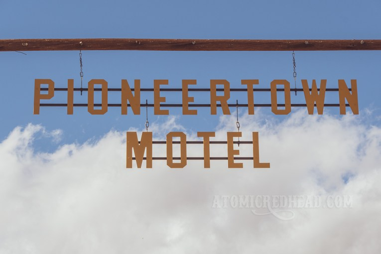 """Large cut out yellow letters spell out """"Pioneertown Motel"""""""
