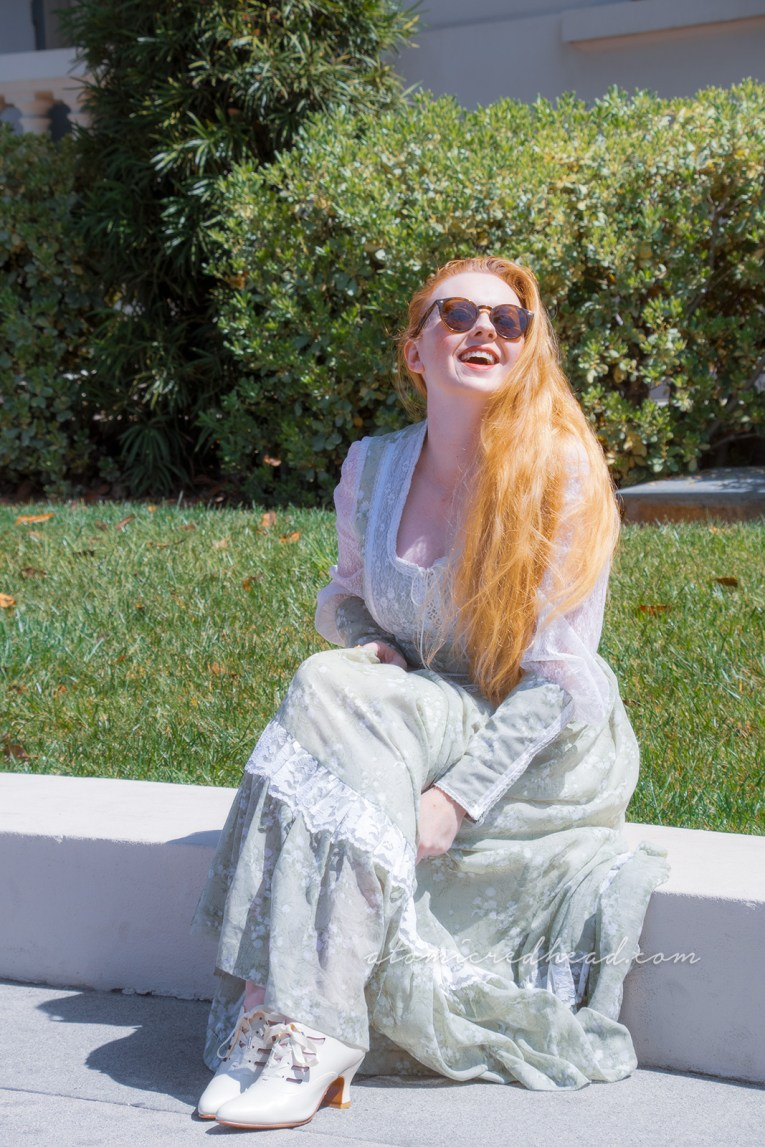 Me, sitting outside Pasadena City Hall, wearing a long pale green dress with small white flowers.