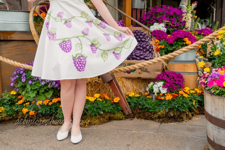 Close up of my skirt, that features hand painted boysenberries on a vine.
