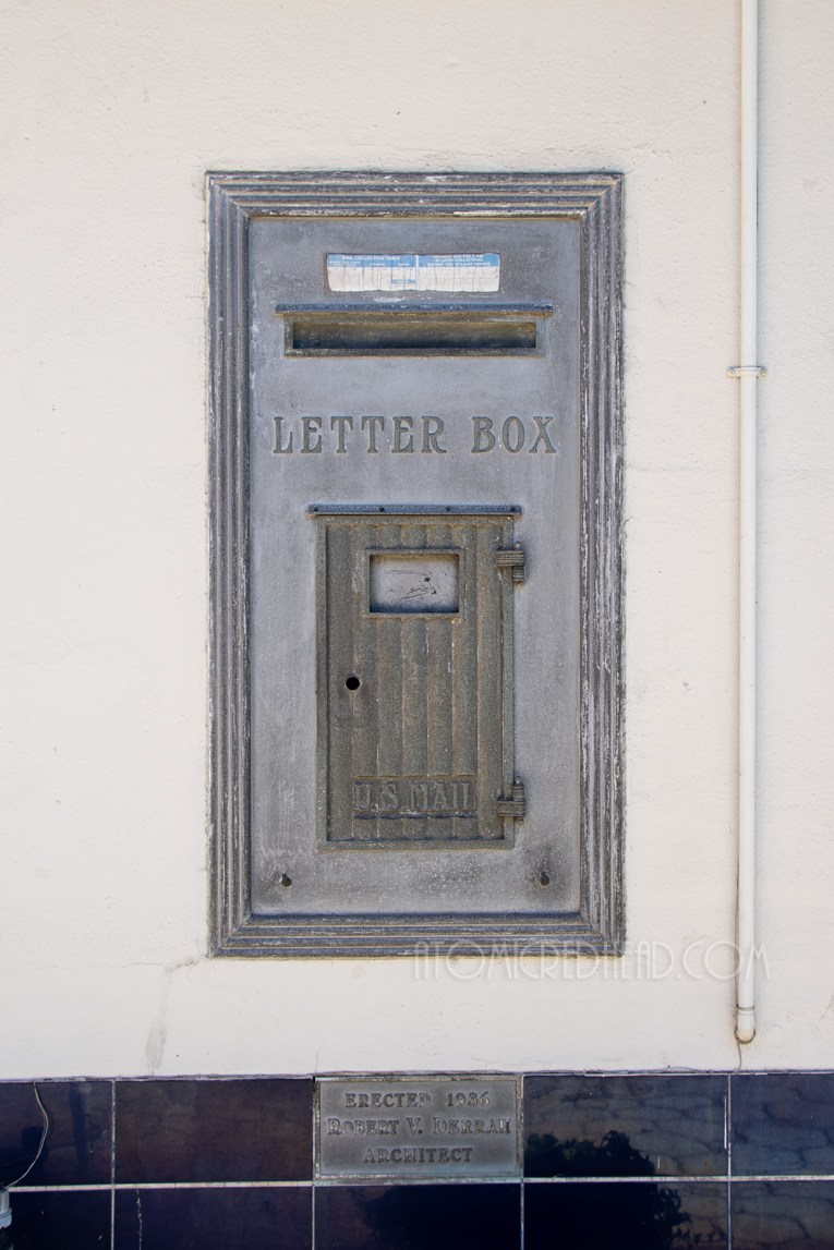 A large metal letter box sits within the walls of the steamship building.