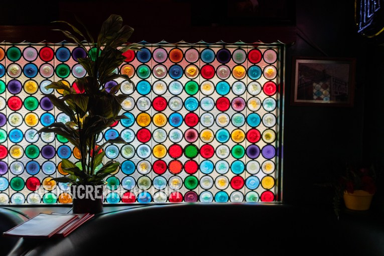 A window made of multiple round pieces of glass of various colors.