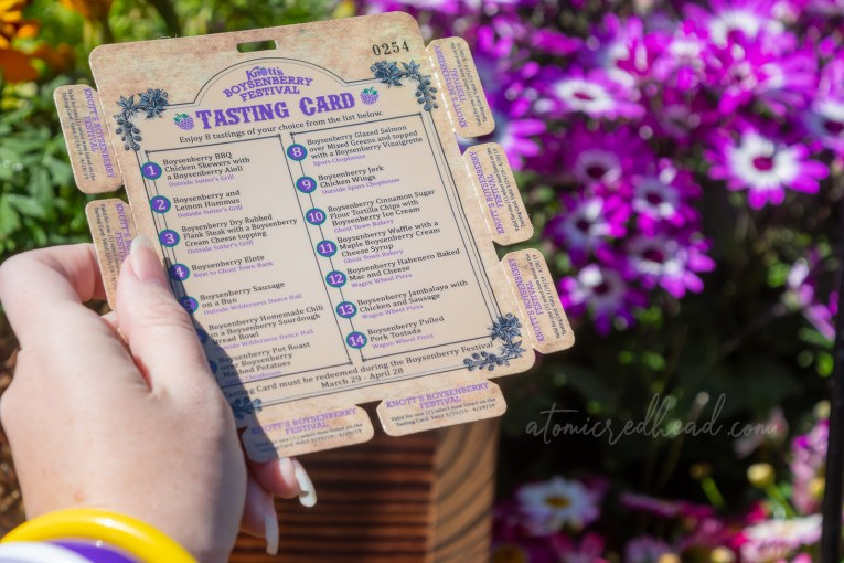 The Boysenberry Festival tasting card, showcasing the list of items, and eight small tabs to pull off to try the various items.