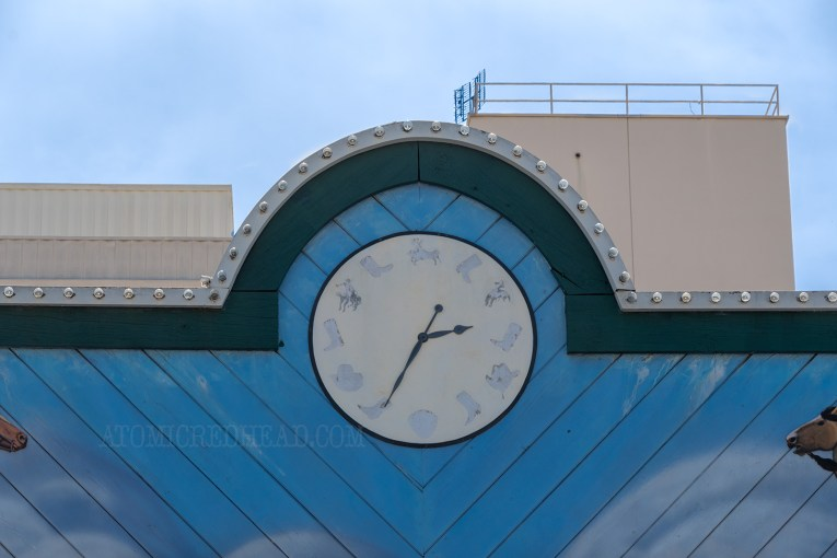 Close-up of the clock face, where boots, horses, and cowboy hats serve as the numbers.