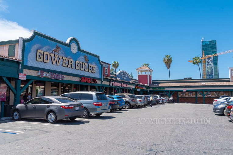 An angled view of the Gower Gulch strip mall with western style facades.