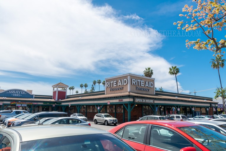 A Rite Aid is situated at the end of the strip mall.