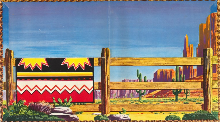 Interior of the folder, which features a desert landscape of cacti, and a fence with a Native American style blanket hanging over it.