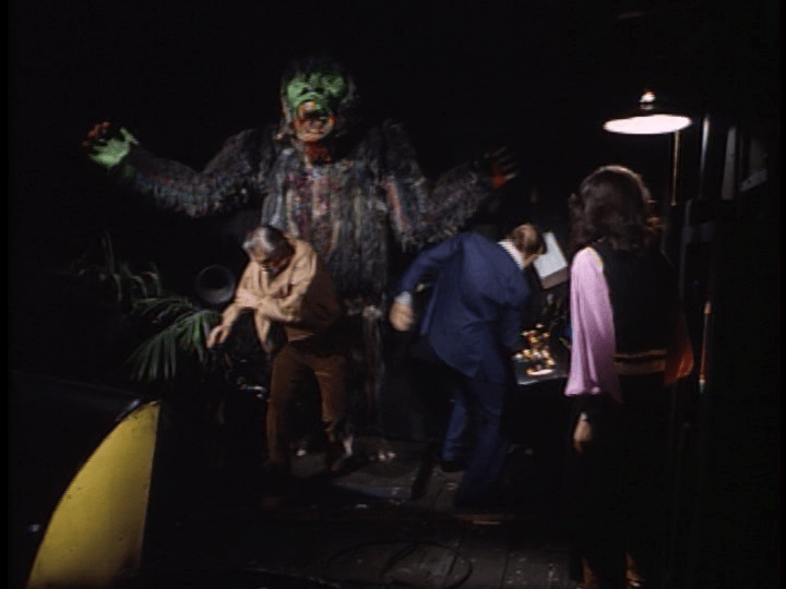 Screencap: A giant ape with a green face lords over Steve and the German spies within Laff in the Dark.