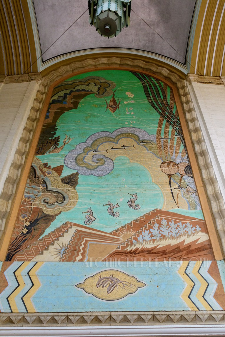 Mural of life under the scene, including sea horses and seaweed.