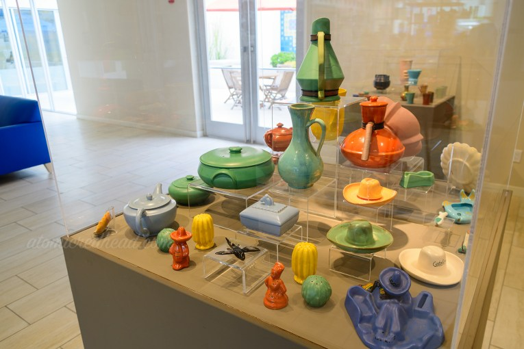 Colorful Catalina Pottery, including pitchers, lidded dishes, and ashtrays.