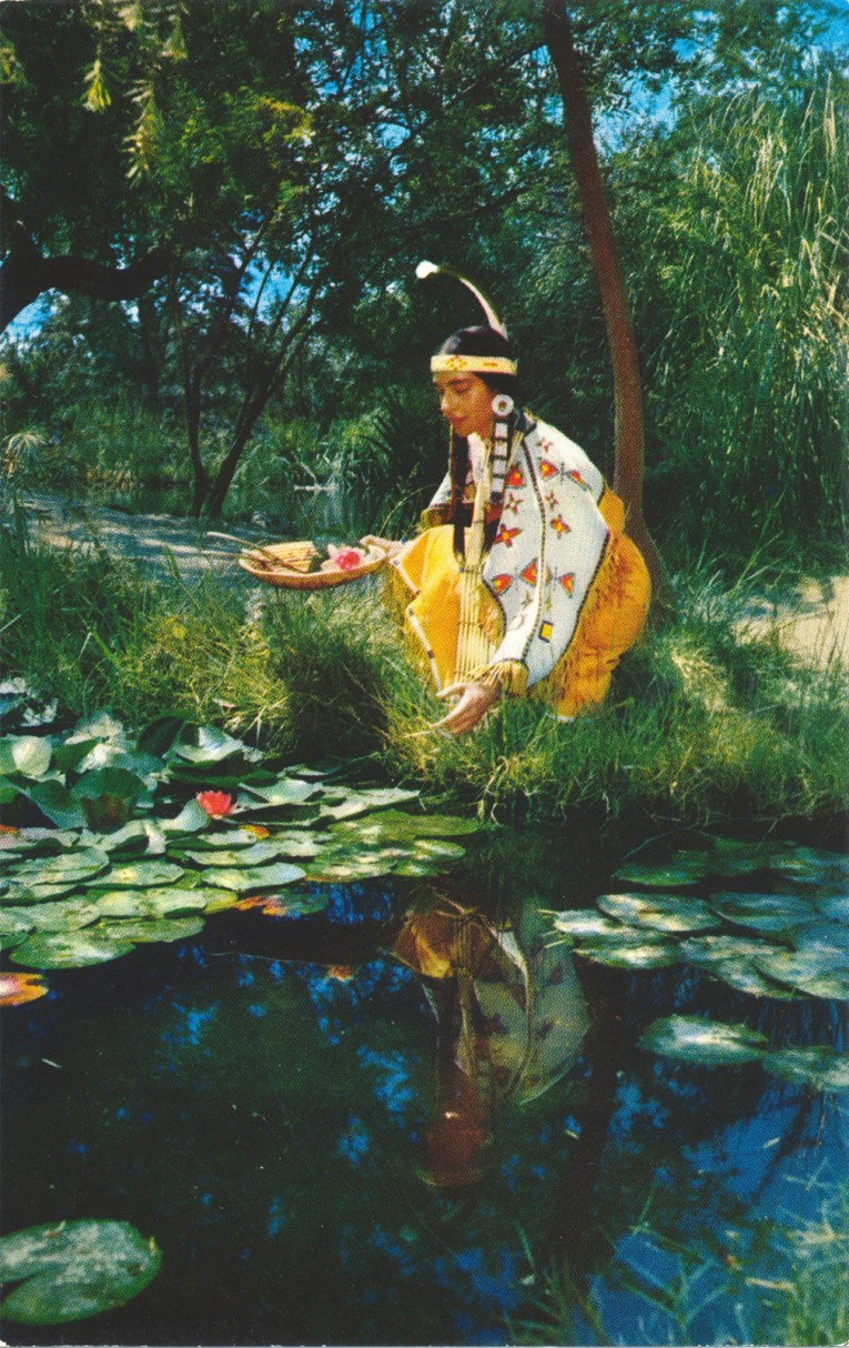 An Indian maiden kneels near a pool.