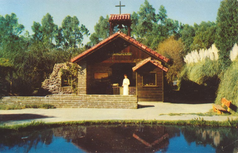 The Little Chapel by the Lake, a small adobe brick church with red tile roof.