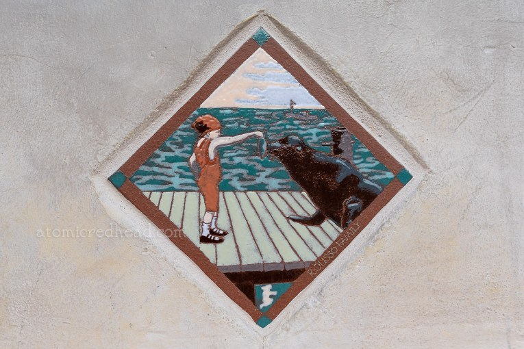 Close up of a tile version of the infamous postcard of Bernice Cameron feeding Old Ben.