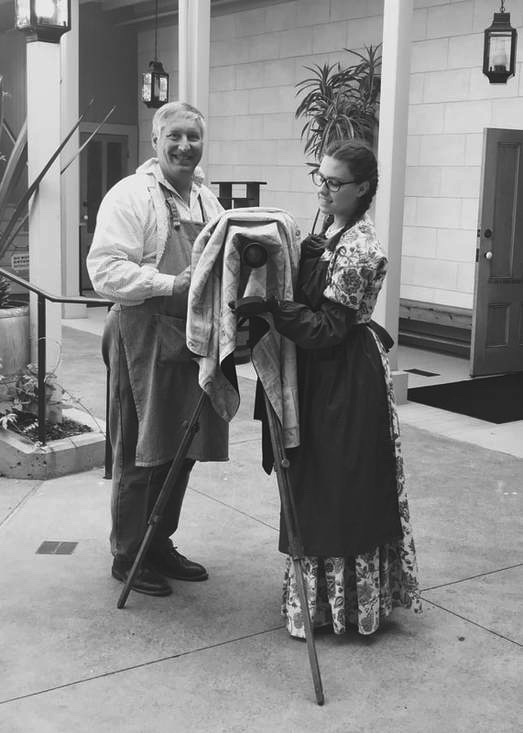 A black and white image of Catherine and her father with their camera.