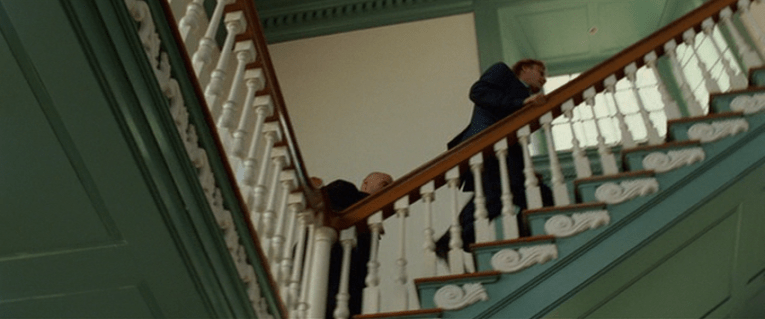 National Treasure Screencap: A group of men walk up a staircase inside Independence Hall.