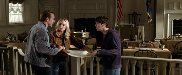 National Treasure Screencap: Ben, Abigail, and Riley look look at the Declaration of Independence inside the signing room of Independence Hall.