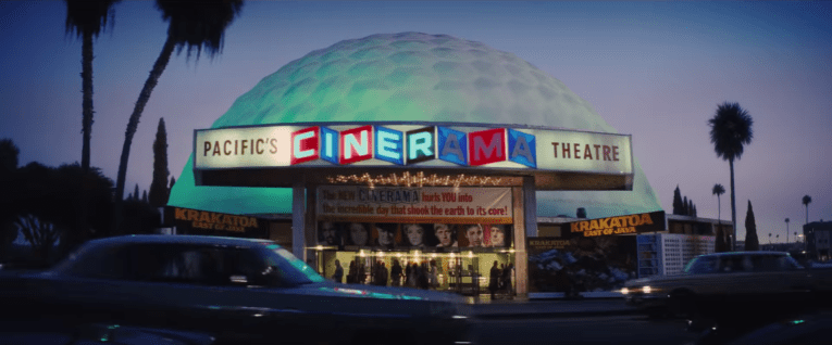 The Dome as seen in Once Upon a Time...in Hollywood, lit up at night, featuring the banner for Krakatoa East of Java. The dome is lite blue.