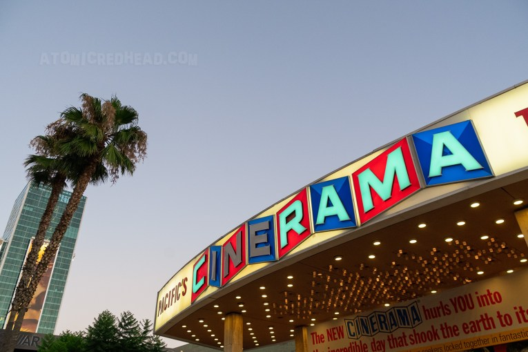 "The Dome at sunset, a red, white, and blue sign reads ""Pacific Cinerama Dome"""