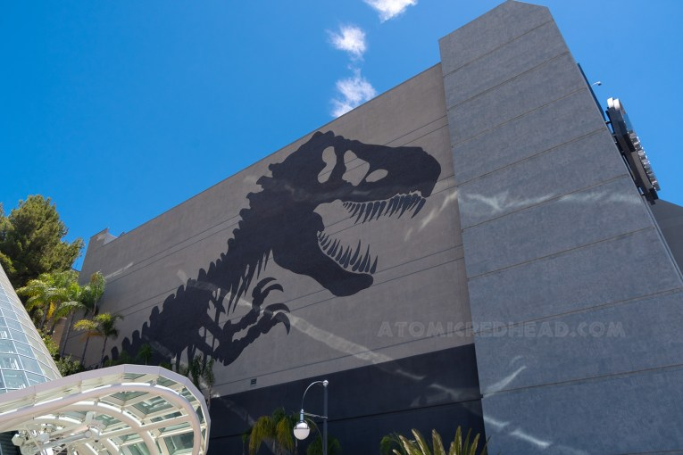On the side of the ride's show building is a massive T-Rex skeleton.