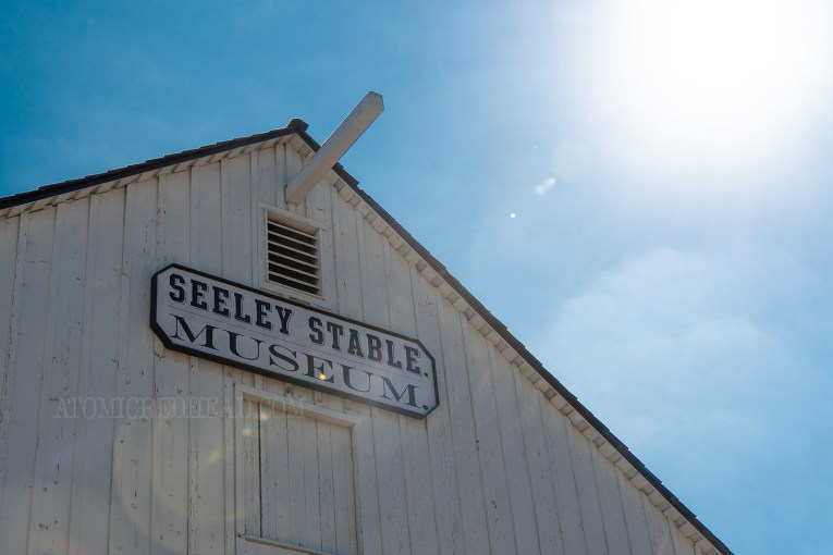 "The top of a white barn, with a sign reading ""Seeley Stable Museum"""