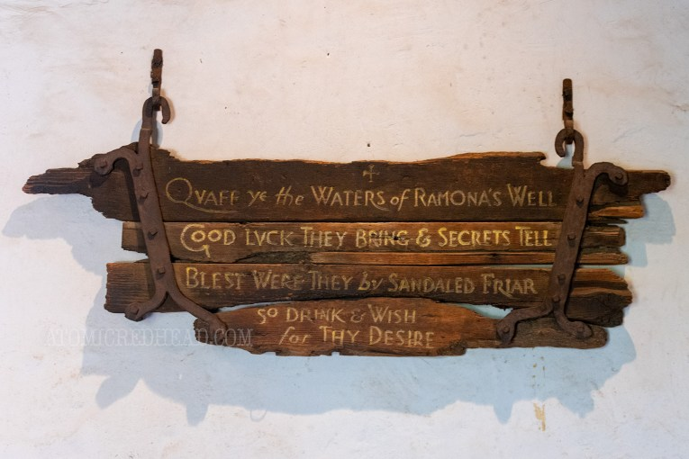 "An old sign from the Ramona's Marriage Place days reading ""Quaff ye the waters of Ramona's Well Good Luck they bring & secrets tell Blest were they by sandaled friar so drink & wish for thy desire"""