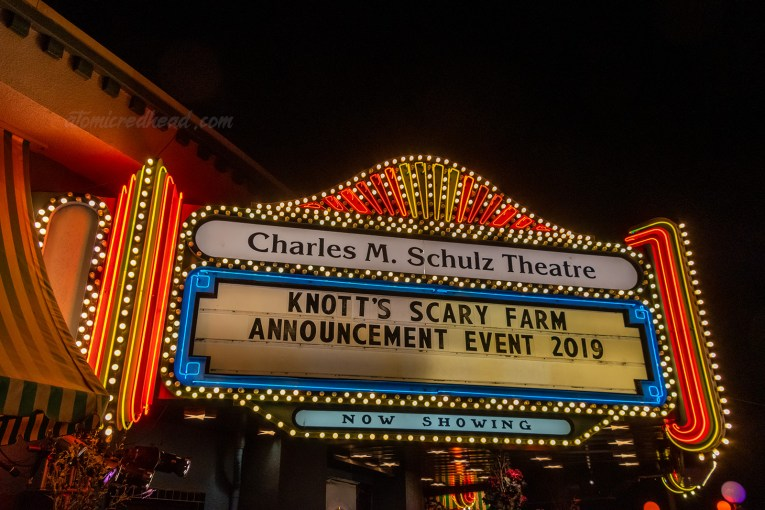 "The neon sign for the Charles M. Schulz Theatre, with yellow and red neon and the marquee reads ""Knott's Scary Farm Announcement Event 2019"""